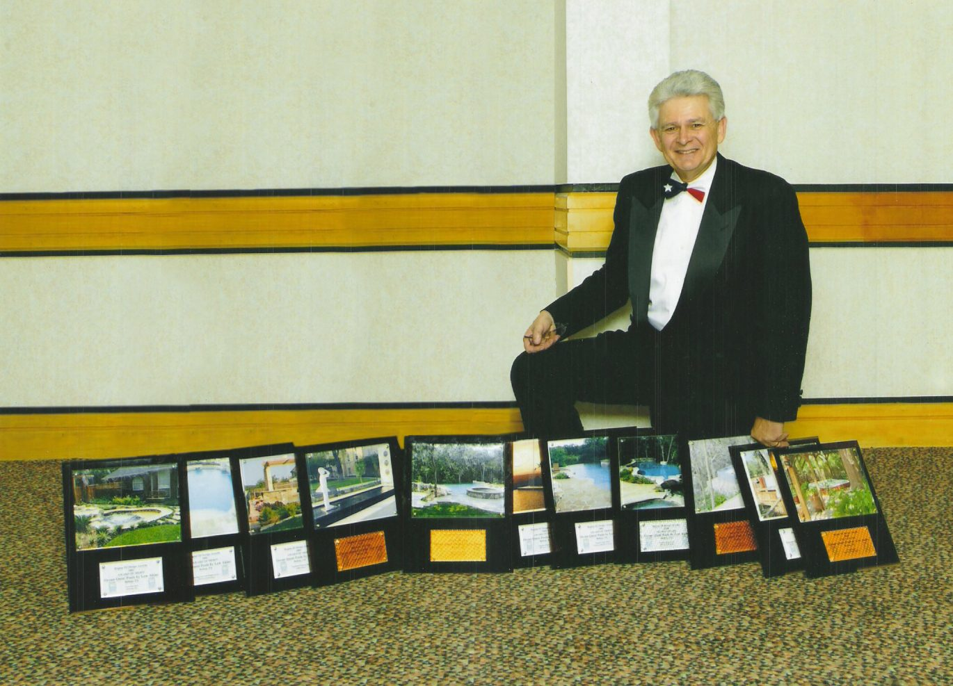 Lew with 11 of 12 Awards, 2004.jpg